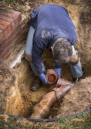 plumber repairing sewer line