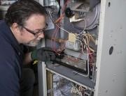 technician doing furnace repair