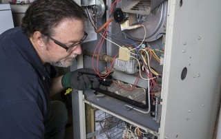 technician doing furnace repair
