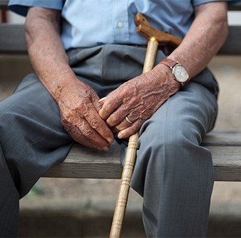 senior citizen with a cane