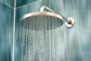 hot water flowing from shower head